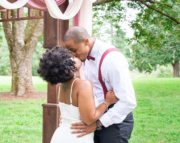 Bride and Groom Kissing each other.